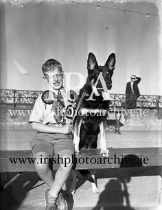 Mater Rodney Ross, son of Mr R Ross, Queen St., Ballymoney, with Mr W Murphy's German Shepherd Dog 'Koleen of Wolfhill' at Bray Dog Show (Winner best in Dog Show Winner, Images Of Ireland, Make Her Smile, Historical Images, Photo Archive, German Shepherd Dogs, Little Sisters, Irish, Queen