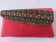 Red Akara wax print African fabric trim cover Africa clutch evening  hand bag purse. Traditional wedding outfit accessory. by ChicAfrica on Etsy https://www.etsy.com/listing/248865704/red-akara-wax-print-african-fabric-trim