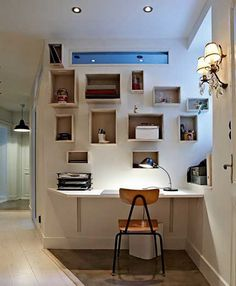 Small Home Office Design Ideas. Randomly placed open cubby boxes mounted on a wall provide stoage for a shelf that is mounted as a desk. As long as there is an electrical outlet available to power your desk lamp and laptop, you are in business. A small filing cabinet could be added under the desktop for additional storage and serve as a place for your printer so that it doesn't take up space on your desktop.