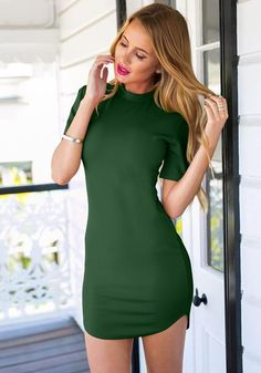 Flaunt your curves and parade your pins in this fashion-perfect dark green curved-hem bodycon dress.