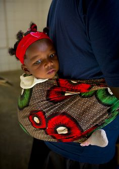 Estas a gusto con tu madre. Baby in Namibe - Angola by Eric Lafforgue, via Flickr