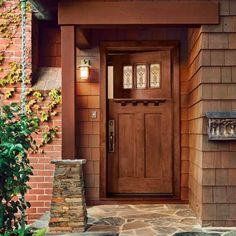 Top-quality fiberglass entry doors have gotten so good at mimicking the look, feel, and thunk of wood that you could swing one open and close it behind you without ever realizing you weren't handling solid mahogany, oak, or pine. | Photo: Courtesy of Jeld-Wen | thisoldhouse.com