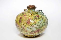 Christopher Taylor, Small Bellied Vessel with Roses, htrown brick clay decorated with coloured slips, under glaze print, lead glaze, lustre and decals, 14cm
