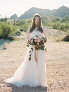 Gown available at Adore Bridal Boutique! www.adorebridalga.com @lovemarleyoffic Amelie gown. OF GEORGIA PHOTOGRAPHY 31