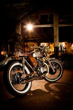 CB350 Steampunk Frankenstein Cafe thing called Isabel.  Easily one of the most creative and detail oriented bikes ever.  Screw you American chopper weak asses.  This is real ingenuity.