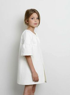 The elbow-grazing bell sleeves lend Lemoniez's pure white coat drama. Fashion Kids, Little Girl Fashion, Little Girl Dresses, Look Fashion, Girls Dresses, Girls White Dress, Kids Mode, Look Girl, Little Fashionista