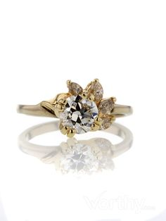 A very original piece: .88 CT European Cut #Solitaire #Ring with a floral take!