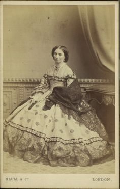 Carte-de-visite photograph by Maull & Co, 1864 London, Manchester Art Gallery  Full length studio portrait of a woman in mourning sittin...