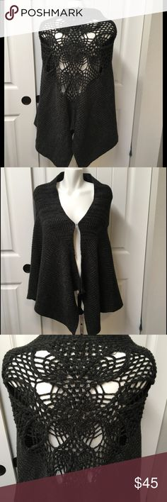 Free People Knit Crochet Poncho Cape OS Gray Stunning Free People crotchet poncho/cape. One size fits all.  Light and dark gray acrylic.  Has a clasp in the front to keep closed.  Absolutely gorgeous back pattern.  Excellent condition and very soft.  See photos.  Ask any questions before purchasing. Free People Jackets & Coats Capes