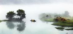 Pastorale Scenery - capture early morning with a Foggy weather after rain related   to  a very natural scenery  in China  for some fishermen.
