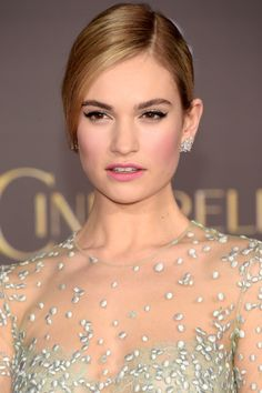 "Who: Lily James What: A Pink Blush  How-To: ""We didn't have to look far for inspiration,"" said makeup artist Jenn Streicher of the flushed look she created for Lily James' Cinderella premiere. ""We wanted to do a fresh, modern version of this classic fairytale."" She focused on rosy pink cheeks that matched the lip color and embraced her porcelain skin and simple black cat-eyes.  Editor's Pick: NARS Blush in Gaity, $30, sephora.com.   - HarpersBAZAAR.com"