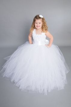 Make your princess stand out with this beautiful White Empire Dress. This multilayer dress is made with yards and yards of premium soft tulle.