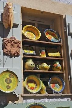 Colourful french pottery on sale at a store in Gou...