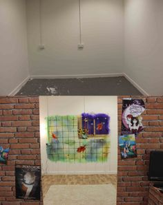 """My degree show space. I tried to create an atmosphere as far removed from a white gallery space as possible as cartoons aren't suited to the atmosphere. I really like the brick wallpaper and have displayed """"Delvin the crazy hobo"""" on the outside as it fits nicely"""