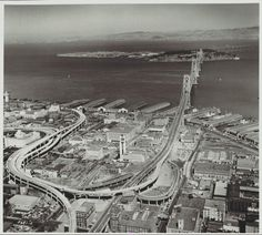 Aerial view of San Francisco, Bay Bridge freeway off ramps to downtown. 1955