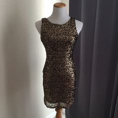 Sexy gold sequence form fitting backless dress! Cute gold dress with gold sequence and black underlay. Never worn! Audrey Dresses Backless