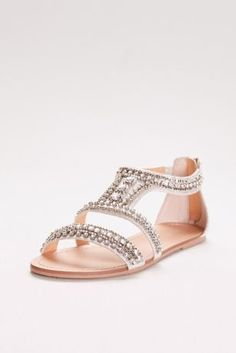 A perfect finishing touch to everything from jeans to ball gowns, these highly embellished sandals are both cool and elegant.   By David's Bridal  Synthetic  Back zipper  Imported