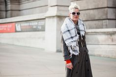 "15 Seriously Stylish Street Looks From London's Hottest Show #refinery29  http://www.refinery29.com/victoria-and-albert-museum-savage-beauty-exhibit-street-style#slide-5  Name: Sarah GinnJob: PhotographerWhat She's Wearing: Gucci sunglasses and vintage coat, scarf, and belt. Ginn likes to play with old-school glamour and club style, but remains a devotee of the ""less is more"" approach. ""It's nice to mix up really feminine looks with more masculine touches,"" the photographer tells us. ""I have…"