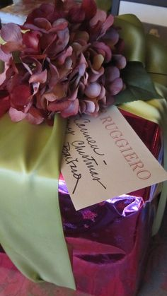 Color for Christmas packages. Lime green satin ribbon and bright pink foil.