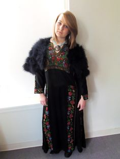 Black embroidered dress with feathered cape
