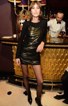 How Alexa Chung Pulled Off a Minidress and Fishnets Like a Pro via @WhoWhatWear