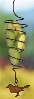 Spiral Fruit Spear Bird. Fruit feeding birds - Orioles, Cardinals, Mocking Birds and more will flock to the fruit spear. Apples and Oranges cut in half are favorites. #spiral #birdfeeder #birdfeeders