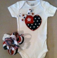 Fourth 4th of July outfit for baby girls - patriotic heart and ribbon onesie and a matching headband w/ boutique bow. $34.00, via Etsy.