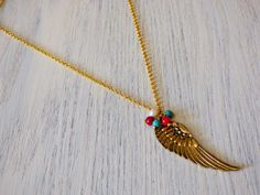 Check out this item in my Etsy shop https://www.etsy.com/es/listing/466575033/golden-wing-necklace-co015