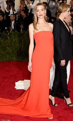A sight to behold: Jaime oozed glamour in a tangerine orange gown when she attended the Met Gala in New York on Monday