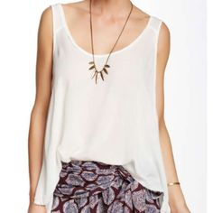 """Free People Swing Cami Flattering fit. Scoop neck, sleeveless & made from a gauzy fabric this camisole will keep you cool when the weather warms.. High-low hem. Color is ivory. Size small. Approximately 23"""" shortest point & 27"""" longest point. Ask if you have questions. Free People Tops"""