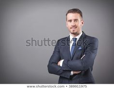 Handsome businessman standing with arms crossed on grey background Arms Crossed, Business Portrait, Clothing Deals, Bad Timing, Make More Money, Gray Background, Sport Coat, Casual Wear, Coupons