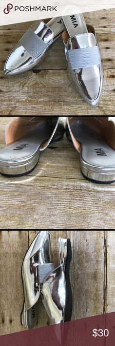 MIA Porscha patent flat Mia Porsche Patent flat• Silver Pat color• pointed toe• Goring vamp strap•slip on • cushion insole • approx 0.5 heel• casual -sleek look• dressed up or down• price sticker residue on bottom on sole• no trades• Bundle for private offer.😊 Mia Shoes Mules & Clogs