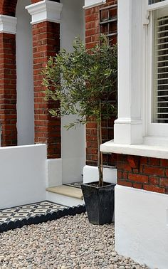 Plastered rendered front garden wall painted white metal wrought iron rail and