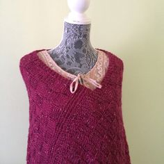 This burgundy poncho is a great fit for any season. It is knitted with very soft 40% Alpaca, 40% Merino Wool, 14% Acrylic , 6% Rayon yarn. It