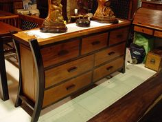 I love the legs on this sideboard - not my style but still love the look!