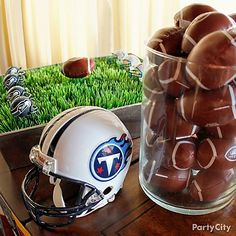 Use football party favors as table decorations to set the scene & treat your guests.