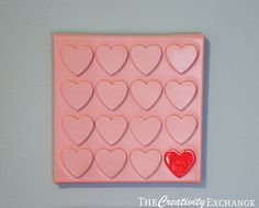 Wall art with foam hearts spray painted on a canvas {Tutorial}