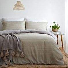 Create a signature look with this perfectly relaxed duvet cover set. With soft earthy tones, this design creates a warm and restful mood. The reversible design allows the subtle ombre effect to give a natural textured appearance whilst the chambray grey reverse is ultra versatile for any bedroom. Made of 100% cotton, this duvet cover set is super soft and snuggly, as well as durable and breathable.
