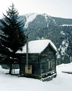 Nestled in the Sarreyer hillside, just beyond a charming village in the Swiss Alps, is a tiny cabin. Designed by Vevey-based firm, Rapin Saiz Architects, the. Little Cabin, Little Houses, Cabins And Cottages, Log Cabins, Cabins In The Woods, Log Homes, Cabana, The Great Outdoors, Tiny House