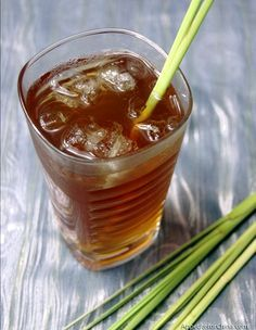 """Thai lemongrass and ginger iced tea-To get the most flavor from your lemongrassafter removing the outer layer, bruise the white ends of your stalks with the blunt edge of a large knife, then thinly slice. (Bruising helps release the lemongrass """"juices"""".) To make the lemongrass syrup, boil the sliced lemongrass with some ginger, and turn off the heat and stir in sugar."""