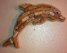 Unique anchor wall art made with solid wood backing and real wine corks. Beautifully bordered with rope. This unique piece will be a great addition to your kitchen, bar, or man-cave. Great gift idea! Overall length is approx. 16 inches . As with all items, custom sizes accepted