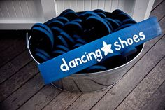 What a great idea! So every lady can take off her heels and have a pair of flip flops to dance in! No bare feet! So so great!!!!
