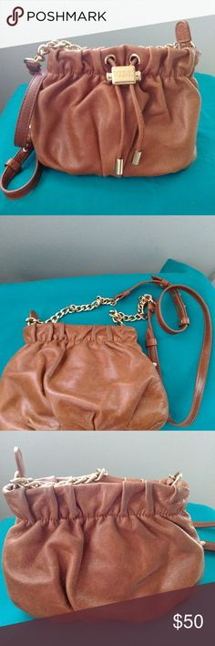 Badgley Mischka cross bag Brown leather cross bag in used but good condition lots of wear left in it great price for this bag Badgley Mischka Bags Crossbody Bags