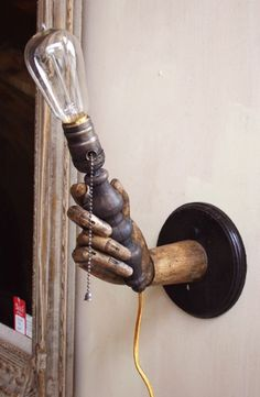 Photo DIY: Hand Me a Light - Easy?! Be discrete with cord - attach to wall, paint wall color. Art supply or craft store for hand? Love this to pieces! Goes with my Skull Designed Bathroom!