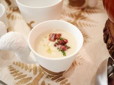 White Velvet Soup : Giada keeps her creamy parsnip-fennel soup warm during the party by serving it in a slow cooker, so guests can help themselves during the event. For a colorful addition, she sets up a toppings bar with a parsley-pomegranate gremolata and crispy bacon bits.