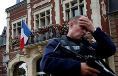 A French police officer reacts to the murder of a priest in Normandy by ISIS.