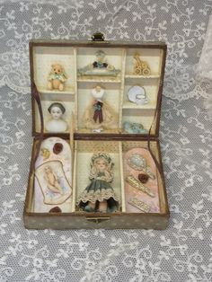 Antique style doll in a box