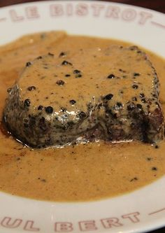 "This steak, served with a peppery cognac crea… Le Bistrot Paul Bert Steak Frites. This steak, served with a peppery cognac cream sauce, wins ""Best in Paris"". Sauce Steak, Beef Steak, Peppercorn Sauce For Steak, Steak Cream Sauce, Pepper Sauce For Steak, Pork, French Dishes, French Food, French Sauces"