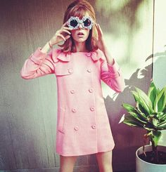 pink coat and funny glasses