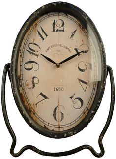 Wilco Imports Oval Metal Table Clock
